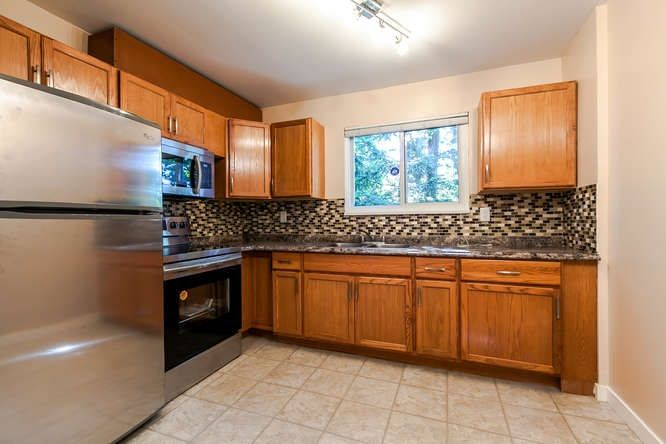 """Main Photo: 7474 13TH Avenue in Burnaby: Edmonds BE Townhouse for sale in """"THE POPLARS"""" (Burnaby East)  : MLS®# R2170196"""