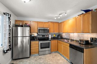 Photo 9: 14 Queen Anne Close SE in Calgary: Queensland Row/Townhouse for sale : MLS®# A1146388