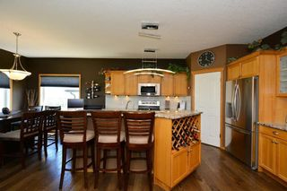 Photo 4: 12 BOW RIDGE Drive: Cochrane House for sale : MLS®# C4129947
