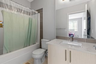 Photo 18: 903 Redstone Crescent NE in Calgary: Redstone Row/Townhouse for sale : MLS®# A1096519
