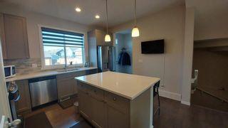 Photo 3: 110 Auburn Meadows Avenue SE in Calgary: Auburn Bay Semi Detached for sale : MLS®# A1095114