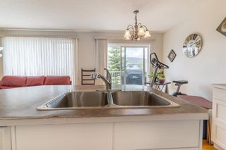 Photo 15: 112 Rocky Vista Circle NW in Calgary: Rocky Ridge Row/Townhouse for sale : MLS®# A1125808