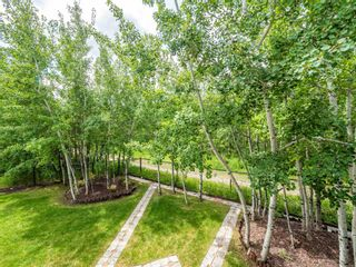 Photo 36: 159 ST MORITZ Drive SW in Calgary: Springbank Hill Detached for sale : MLS®# A1116300