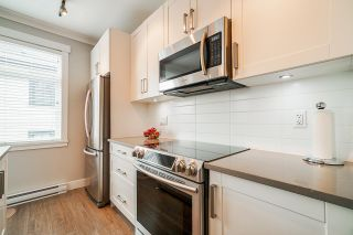 "Photo 12: 105 218 BEGIN Street in Coquitlam: Maillardville Townhouse for sale in ""BEGIN SQUARE"" : MLS®# R2545847"