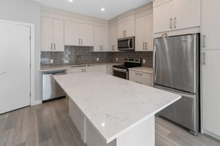 Photo 9: 903 Redstone Crescent NE in Calgary: Redstone Row/Townhouse for sale : MLS®# A1096519