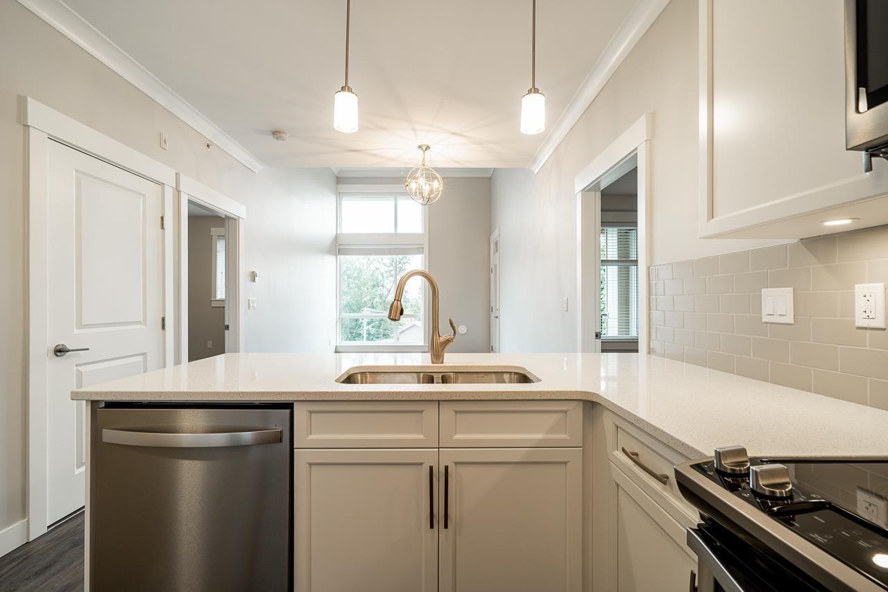 "Main Photo: 411 45761 STEVENSON Road in Sardis: Sardis East Vedder Rd Condo for sale in ""Park Ridge"" : MLS®# R2610329"