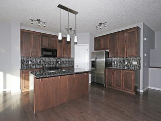 Photo 4: 142 SAGE BANK Grove NW in Calgary: Sage Hill House for sale : MLS®# C4149523