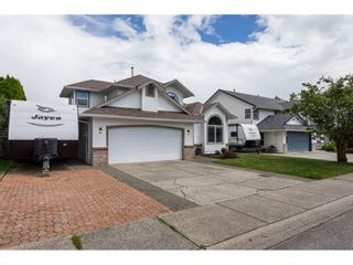 """Photo 1: 35443 LETHBRIDGE Drive in Abbotsford: Abbotsford East House for sale in """"Sandyhill"""" : MLS®# R2378218"""