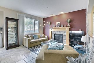 Photo 4: 34 Crestmont Drive SW in Calgary: Crestmont Detached for sale : MLS®# A1119055
