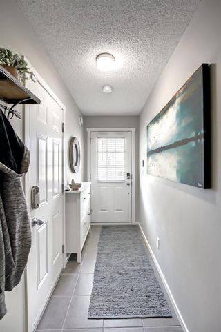 Photo 3: 1103 125 Panatella Way NW in Calgary: Panorama Hills Row/Townhouse for sale : MLS®# A1143179