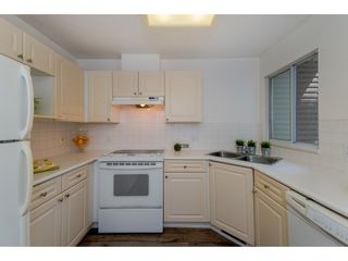 """Photo 7: 210 13900 HYLAND Road in Surrey: East Newton Townhouse for sale in """"Hyland Grove"""" : MLS®# R2295690"""