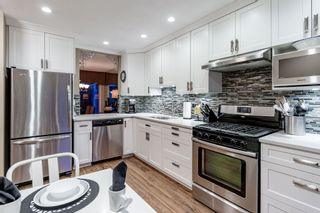 """Photo 1: 18 2590 AUSTIN Avenue in Coquitlam: Coquitlam East Townhouse for sale in """"AUSTIN WOODS"""" : MLS®# R2369041"""