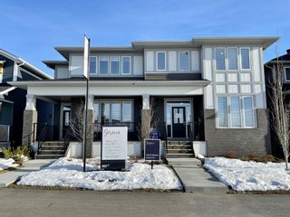 Photo 1: 116 Creekside Drive SW in Calgary: C-168 Semi Detached for sale : MLS®# A1060934