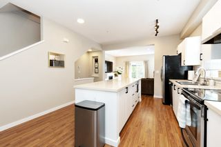 """Photo 12: 10 19572 FRASER Way in Pitt Meadows: South Meadows Townhouse for sale in """"Coho II"""" : MLS®# R2613378"""