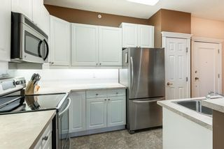Photo 9: 310 910 70 Avenue SW in Calgary: Kelvin Grove Apartment for sale : MLS®# A1061189