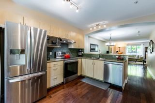 """Photo 4: 141 6747 203 Street in Langley: Willoughby Heights Townhouse for sale in """"Sagebrook"""" : MLS®# R2621016"""