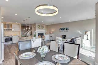 """Photo 7: 124 2721 ATLIN Place in Coquitlam: Coquitlam East Townhouse for sale in """"THE TERRACES"""" : MLS®# R2569450"""
