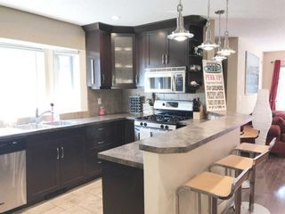 Photo 1: 3712A 41 Street SW in Calgary: Glenbrook Semi Detached for sale : MLS®# A1100932