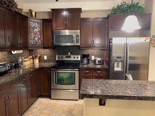 Photo 14: 302 77 GEORGE FOX Trail: Cochrane Apartment for sale : MLS®# A1070866