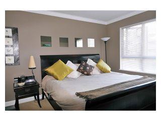 """Photo 1: 226 801 KLAHANIE Drive in Port Moody: Port Moody Centre Condo for sale in """"INGLENOOK"""" : MLS®# V869106"""