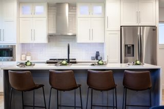 Photo 10: 7411 7 Street SW in Calgary: Kingsland Detached for sale : MLS®# A1021335