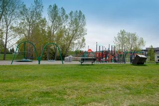 Photo 42: 32 Prominence Park SW in Calgary: Patterson Row/Townhouse for sale : MLS®# A1112438