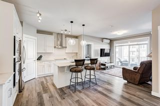 Photo 2: 310 200 Auburn Meadows Common SE in Calgary: Auburn Bay Apartment for sale : MLS®# A1153208
