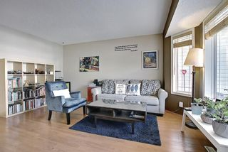 Photo 2: 403 950 Arbour Lake Road NW in Calgary: Arbour Lake Row/Townhouse for sale : MLS®# A1140525