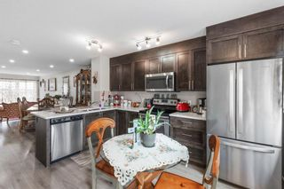 Photo 4: 136 Red Embers Gate NE in Calgary: Redstone Row/Townhouse for sale : MLS®# A1136048