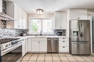 Photo 7: 459 Queen Charlotte Road SE in Calgary: Queensland Detached for sale : MLS®# A1122590