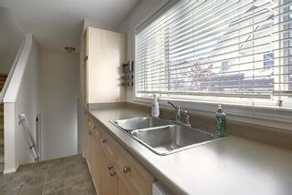 Photo 16: 25 Tuscany Springs Gardens NW in Calgary: Tuscany Row/Townhouse for sale : MLS®# A1053153