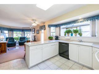 "Photo 13: 144 16080 82 Avenue in Surrey: Fleetwood Tynehead Townhouse for sale in ""Ponderosa Estates"" : MLS®# R2604056"