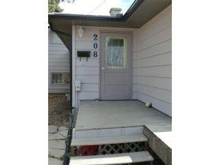 Photo 2: 208 CENTRE Avenue: Cochrane House for sale : MLS®# C4057393