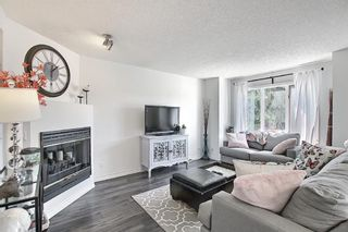 Photo 18: 154 388 Sandarac Drive NW in Calgary: Sandstone Valley Row/Townhouse for sale : MLS®# A1115422