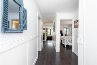 "Photo 2: 116 15275 19 Avenue in Surrey: King George Corridor Condo for sale in ""Village Terrace"" (South Surrey White Rock)  : MLS®# R2572050"