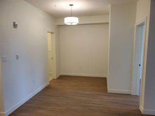 Photo 10: #105 17 COLUMBIA AV W: Devon Condo for sale