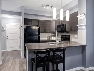 Photo 4: 213 207 SUNSET Drive: Cochrane Apartment for sale : MLS®# A1026900