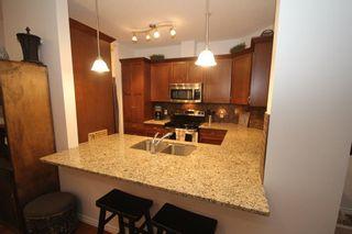 Photo 6: 2101 4 Kingsland Close SE: Airdrie Apartment for sale : MLS®# A1117201