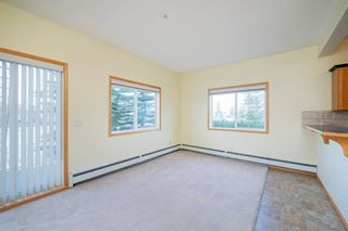 Photo 2: 101 72 Quigley Drive: Cochrane Apartment for sale : MLS®# A1091486