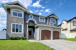 Photo 1: 105 KINNIBURGH Bay: Chestermere Detached for sale : MLS®# A1116532