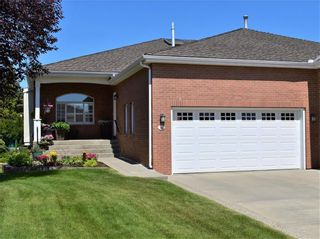 Photo 1: 36 Prominence Point SW in Calgary: Patterson Semi Detached for sale : MLS®# C4279662