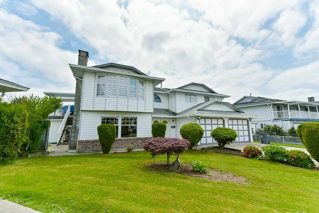 Main Photo: 7710 122A Street in Surrey: West Newton House for sale : MLS®# R2423911