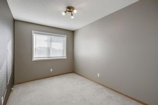 Photo 23: 105 Rocky Ridge Court NW in Calgary: Rocky Ridge Row/Townhouse for sale : MLS®# A1069587