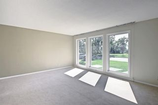 Photo 5: 216 Silver Springs Green NW in Calgary: Silver Springs Detached for sale : MLS®# A1147085