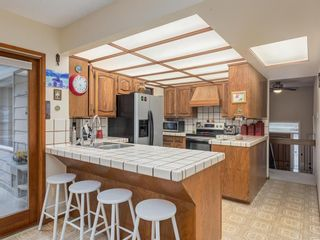 Photo 9: 9804 Palishall Road SW in Calgary: Palliser Detached for sale : MLS®# A1040399