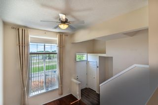 Photo 11: 119 Toscana Gardens NW in Calgary: Tuscany Row/Townhouse for sale : MLS®# A1121039