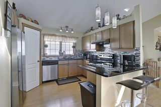 Photo 10: 187 Bridlewood Circle SW in Calgary: Bridlewood Detached for sale : MLS®# A1110273