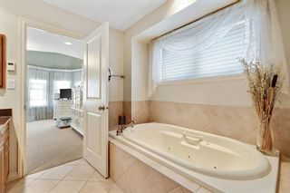Photo 32: 36 Versailles Gate SW in Calgary: Garrison Woods Row/Townhouse for sale : MLS®# A1098876