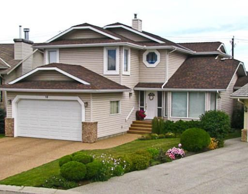 Professionally Landscaped yard with great curb appeal.  New pebble finished driveway, sidewalk and steps.