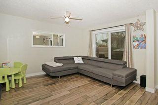 Photo 4: 212 MT APEX Green SE in Calgary: McKenzie Lake House for sale : MLS®# C4144299